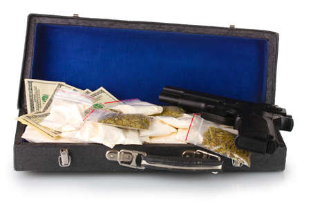 Cocaine and marijuana with gun in a suitcase isolated on white photo