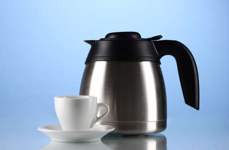 electric tea kettle: Teapot and cup on blue background Stock Photo