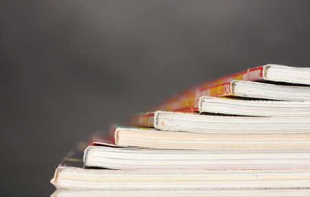 stack of magazines on gray background photo