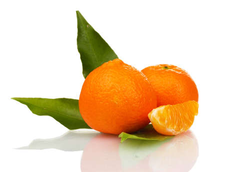 Ripe tasty tangerines with leaves and segments isolated on white Stock Photo - 12101896
