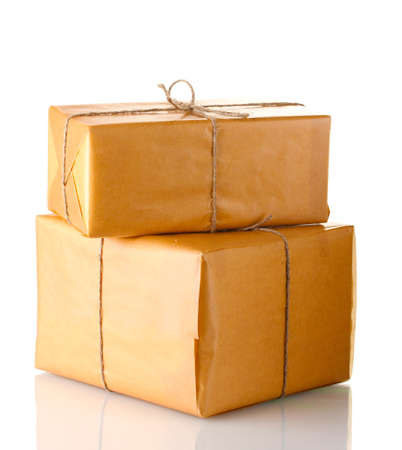 Two parcels wrapped in brown paper tied with twine arranged in stack isolated on white photo