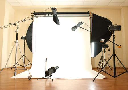Empty photo studio with lighting equipment photo