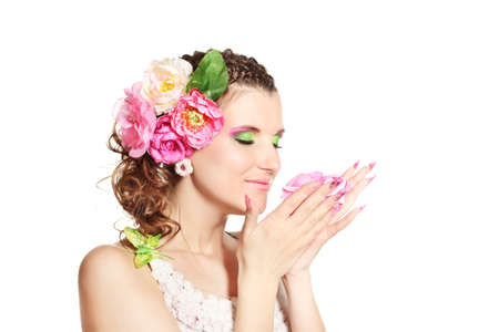Beautiful girl with flowers in her hair isolated on white Stock Photo - 12113662