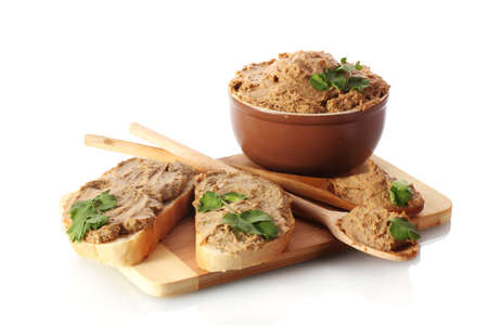 Fresh pate with bread on wooden board isolated on white photo