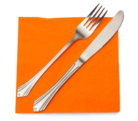 Fork and knife in a orange cloth isolated on white Stock Photo - 12112414