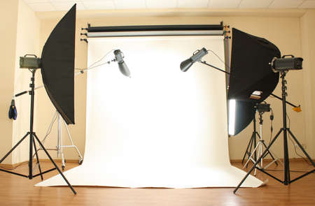 photo studio background: Empty photo studio with lighting equipment