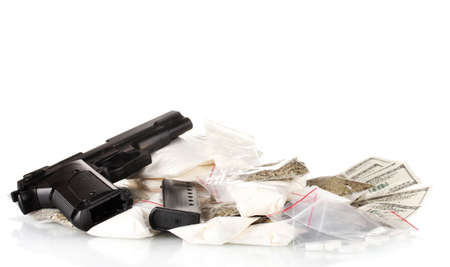 meth: Cocaine and marijuana in packet with gun isolated on white