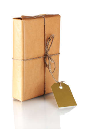 Parcel wrapped in brown paper tied with twine and with blank label isolated on white photo