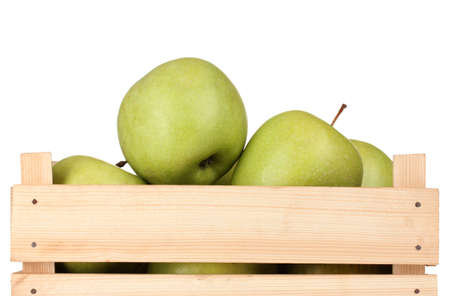 juicy green apples in a wooden crate isolated on white Stock Photo - 12143857