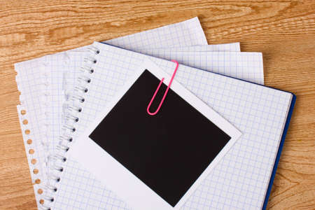 Photo paper and notebook on wooden background photo