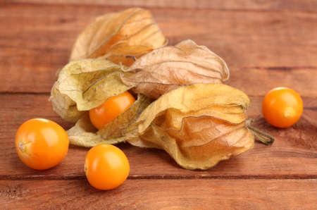 Physalis heap on wooden background photo