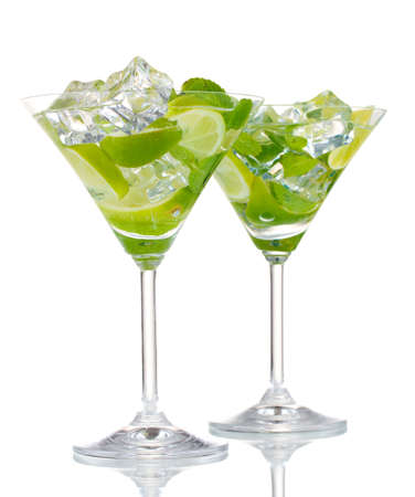 mohito: glasses of cocktail with lime and mint isolated on white