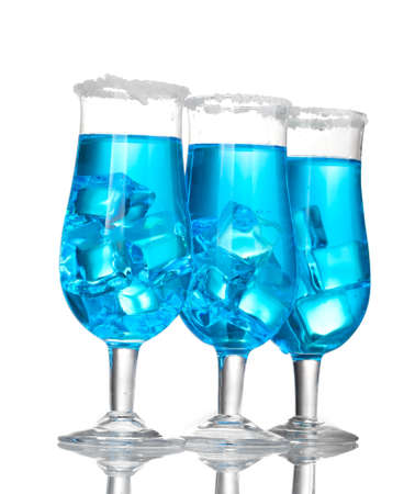 Blue cocktail in glasses with ice and sugar isolated on white photo