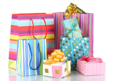 bright gift bags and gifts isolated on white photo