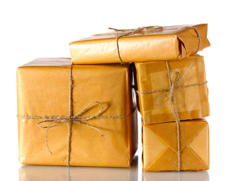 package: Many parcels wrapped in brown paper tied with twine isolated on white Stock Photo