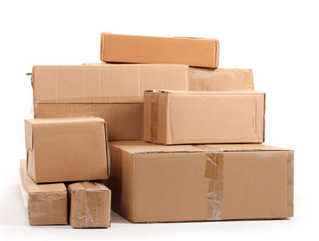 pile reuse: Brown cardboard boxes isolated on white