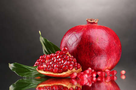 ripe pomegranate fruit on gray background Stock Photo - 12144633