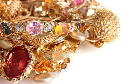 Vaus gold jewellery isolated on white Stock Photo - 12144644