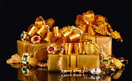 green and gold: Various gold jewellery and gifts on black background