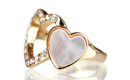beautiful gold ring with precious stones isolated on white photo