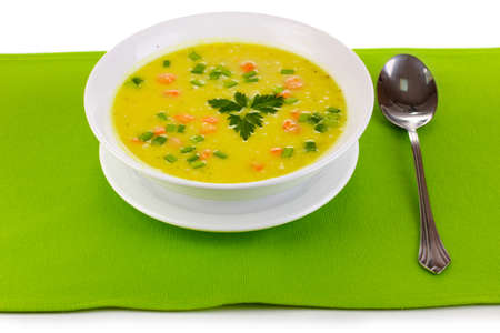 Tasty soup on green tablecloth isolated on white Stock Photo - 12144653