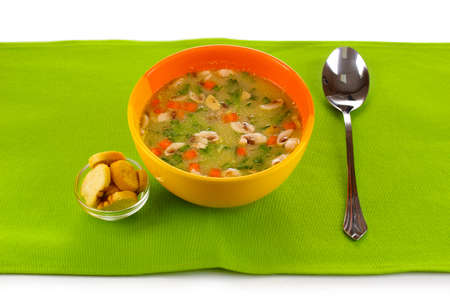 Tasty soup on green tablecloth photo