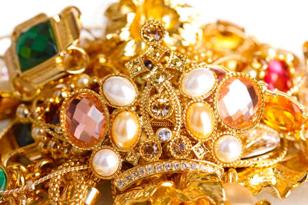 gold jewelry: Various gold jewellery isolated on white Stock Photo