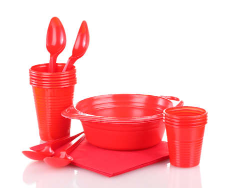 Bright red plastic tableware and napkins isolated on white photo