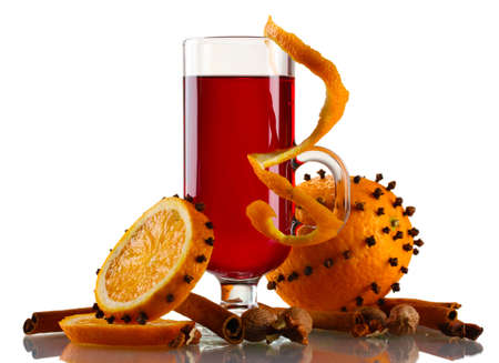 grog: mulled wine in the glass, spice and orange isolated on white