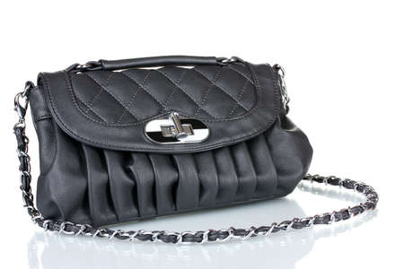 Beautiful leather bag isolated on white photo