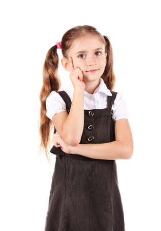 beautiful little girl in school uniform isolated on white photo