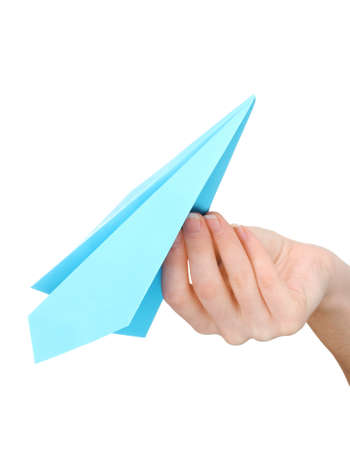Origami paper airplane in hand isolated on white photo