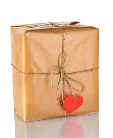 Parcel with blank heart-shaped label isolated on white photo