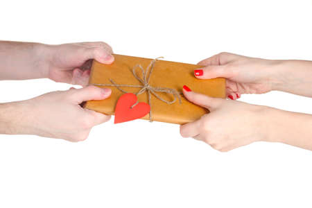 Mans hand giving parcel with blank heart-shaped label to woman isolated on white photo