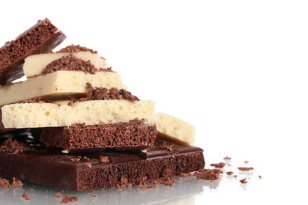 Slices of milk and white chocolate bar with chocolate shavings isolated on white photo