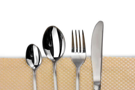Fork, spoon and knife on a beige tablecloth photo