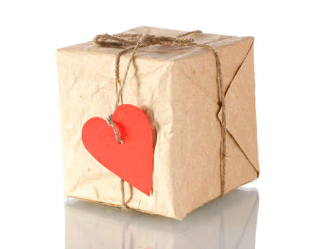 Small parcel with blank heart-shaped label isolated on white photo