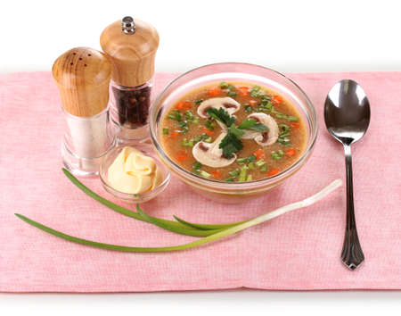 Tasty soup on pink tablecloth isolated on white photo