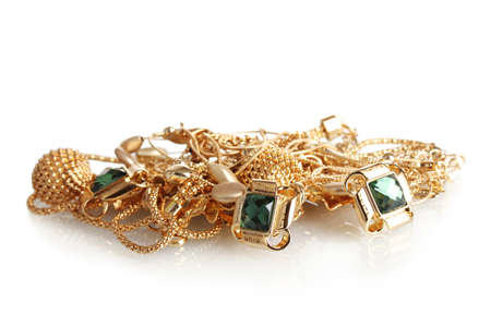 Various gold jewellery isolated on white photo