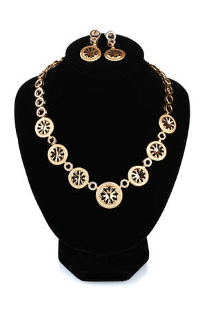 beautiful gold necklace with diamond and earrings on mannequin isolated on white photo
