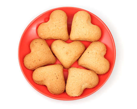 Heart-shaped cookies on red saucer isolated on white Stock Photo - 12238258