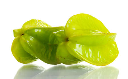 two fresh carambola fruits isolated on white photo