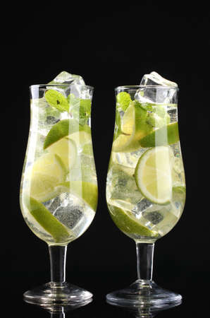 glasses of cocktails with lime and mint on black background Stock Photo - 12238271