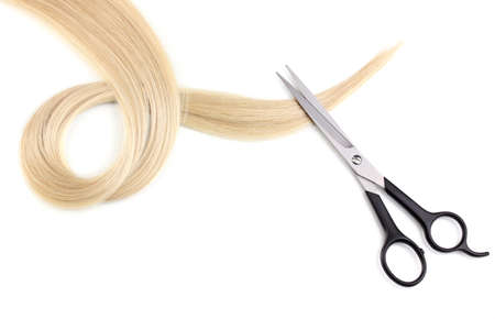 Shiny blond hair and hair cutting shears isolated on white Stock Photo - 12266434