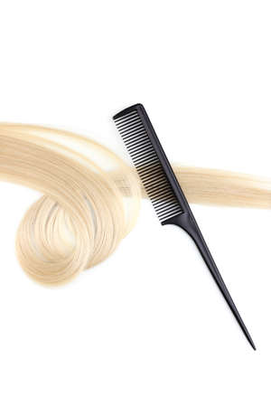 Shiny blond hair and comb isolated on white Stock Photo - 12266420