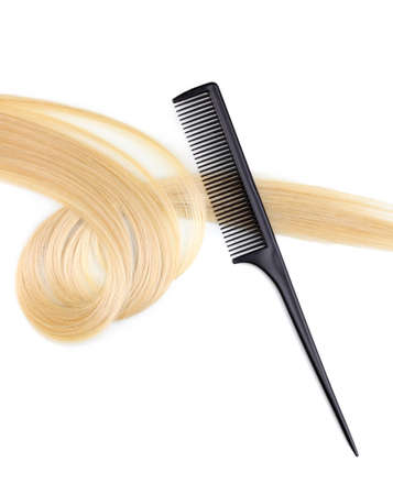 Shiny blond hair and comb isolated on white Stock Photo - 12266425