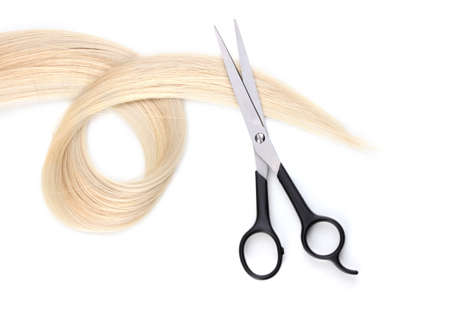 Shiny blond hair and hair cutting shears isolated on white Stock Photo - 12266423