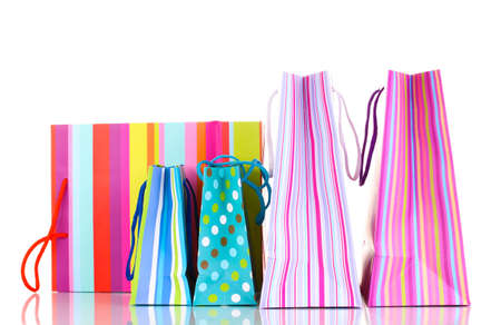 Colorful gift bags isolated on white photo