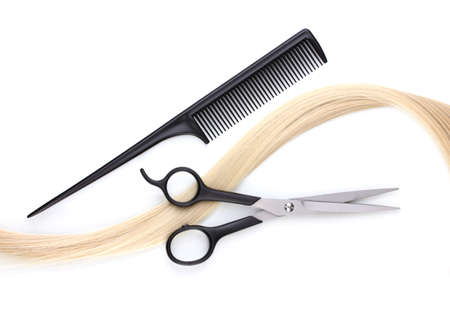 Shiny blond hair with hair cutting shears and comb isolated on white Stock Photo - 12266069