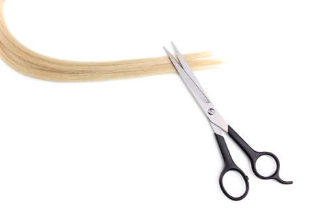Shiny blond hair and hair cutting shears isolated on white Stock Photo - 12266063